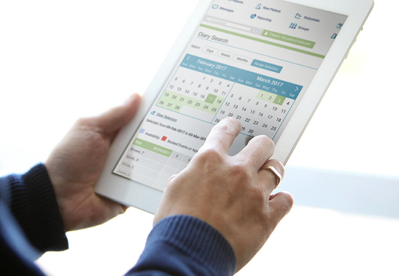 Person holding iPad with iaptus diary open on screen